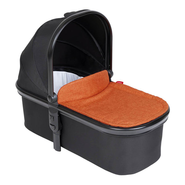 phil&teds snug carrycot in rust orange colour