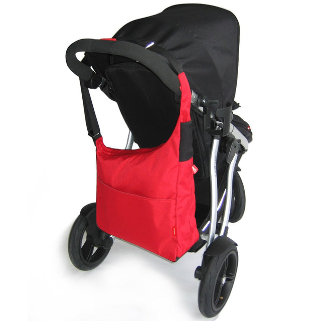 phil&teds diddie diaper bag in red hanging on the handle bar of a buggy_red