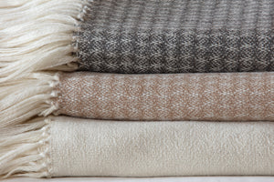 Araminta Campbell undyed British alpaca throws for the home, woven in Scotland.