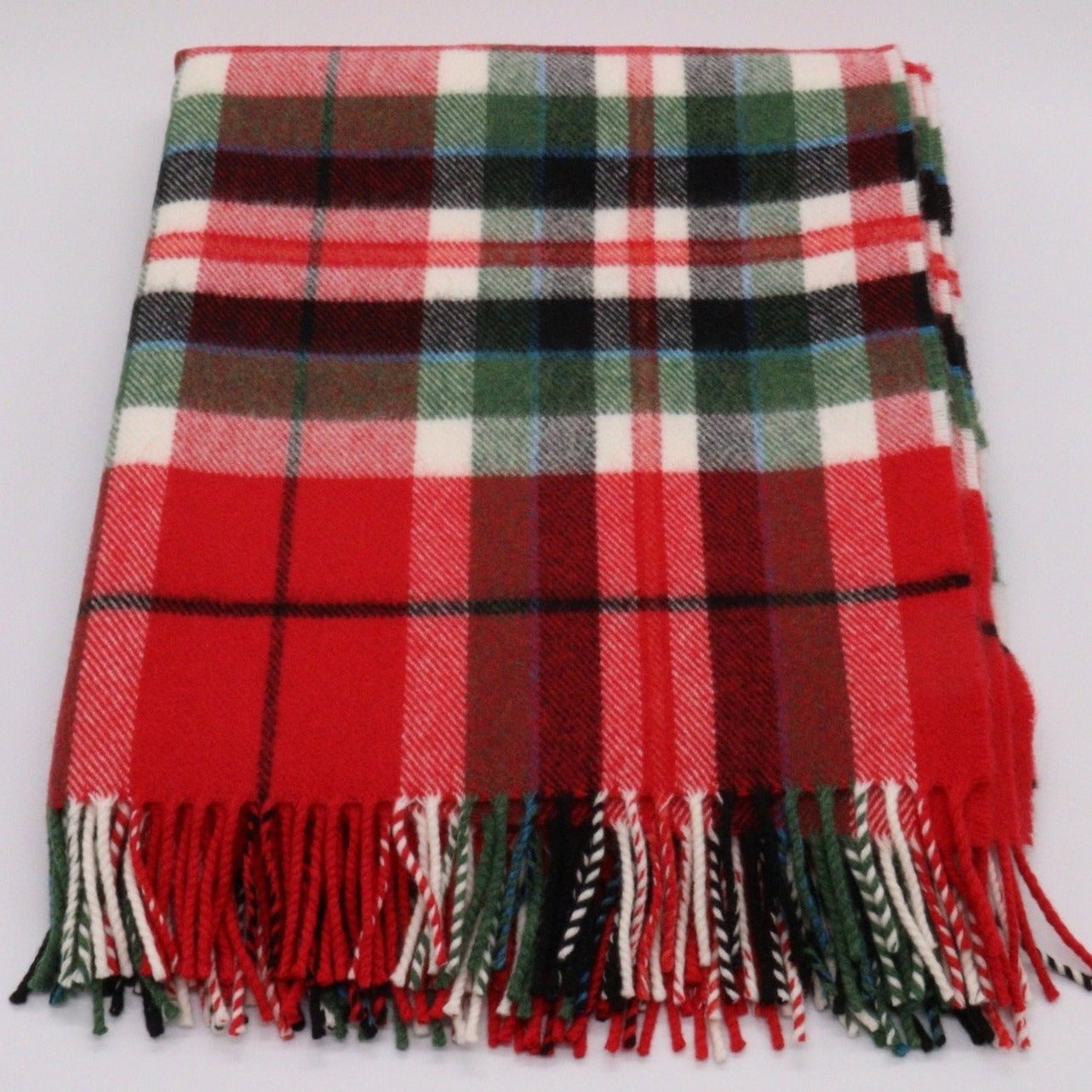 red, white  and green tartan throw