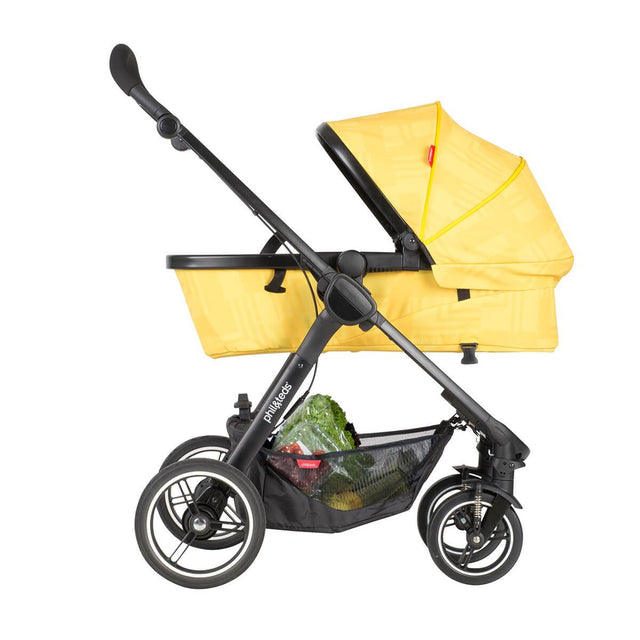 phil&teds mod carrycot in zest colour in parent facing mode side view_zest