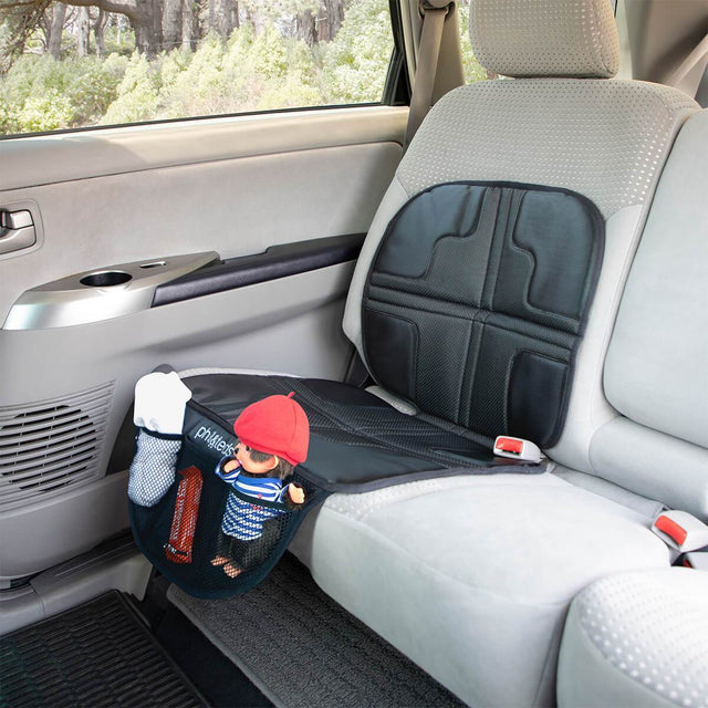 phil&teds® vehicle seat mate™ shown in car with items in the three storage pockets to highhlight ease of access_black