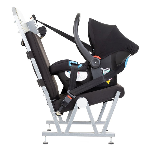 alpha™ infant car seat shown on a car seat demonstrating safe attachment in your vehicle using only your car's seat belt_black/grey marl