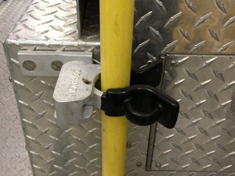 #81 Utility bracket by Zephyr Industries securely holding Pike pole on fire truck