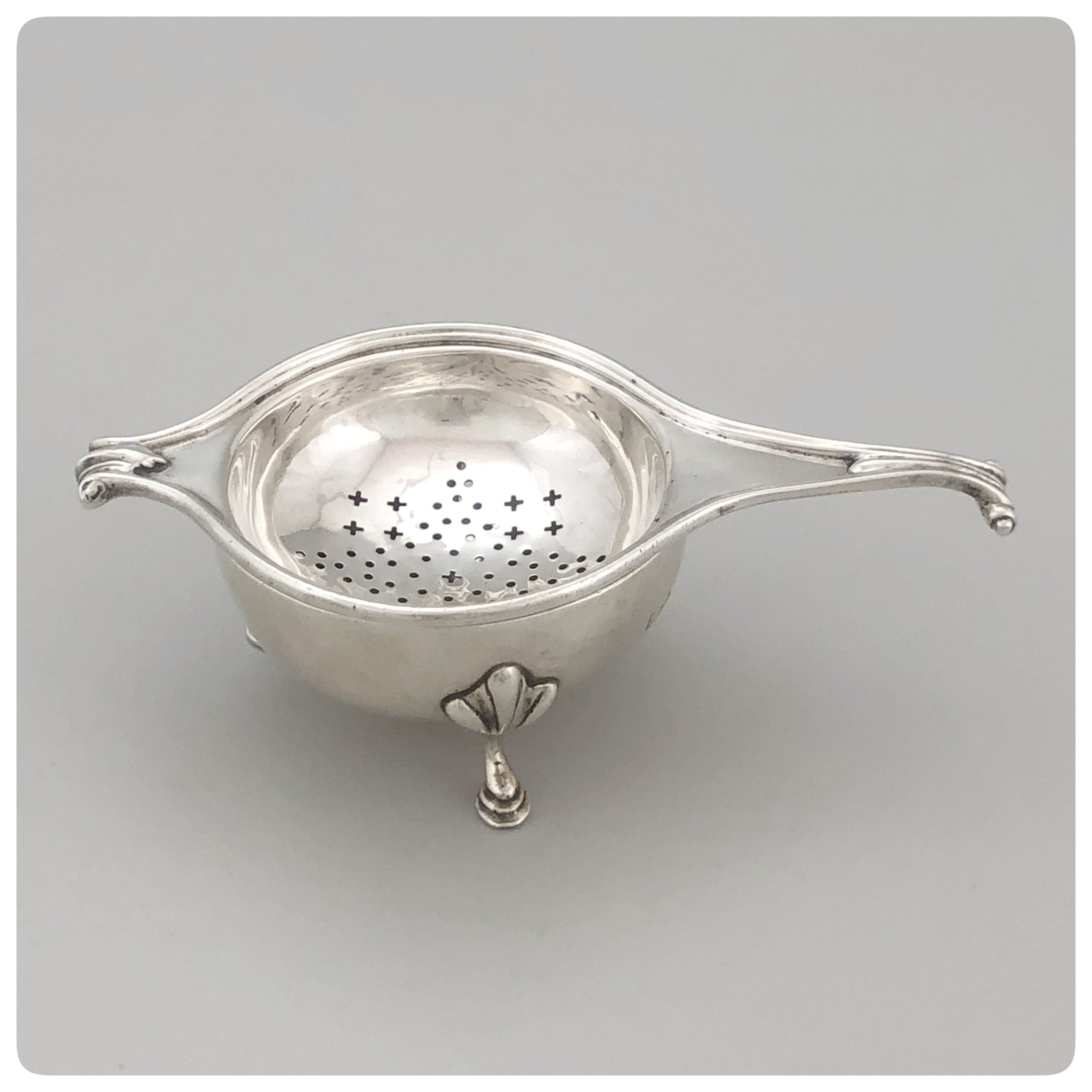 English Sterling Silver Tea Strainer and Stand, Lionel Alfred Crichton, London, 1927-1928