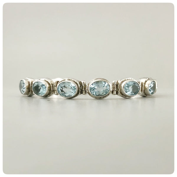 Sterling Silver and 12 Oval Faceted Blue Topaz Line Bracelet, Bali, New - The Silver Vault of Charleston
