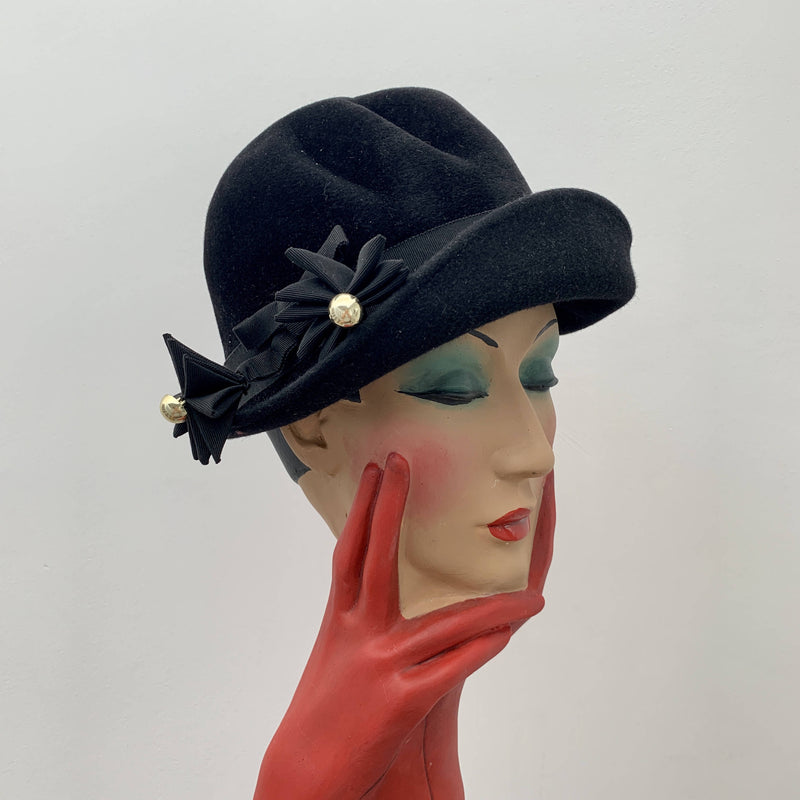 Vintage black and gold cloche decorated hat by Bermona