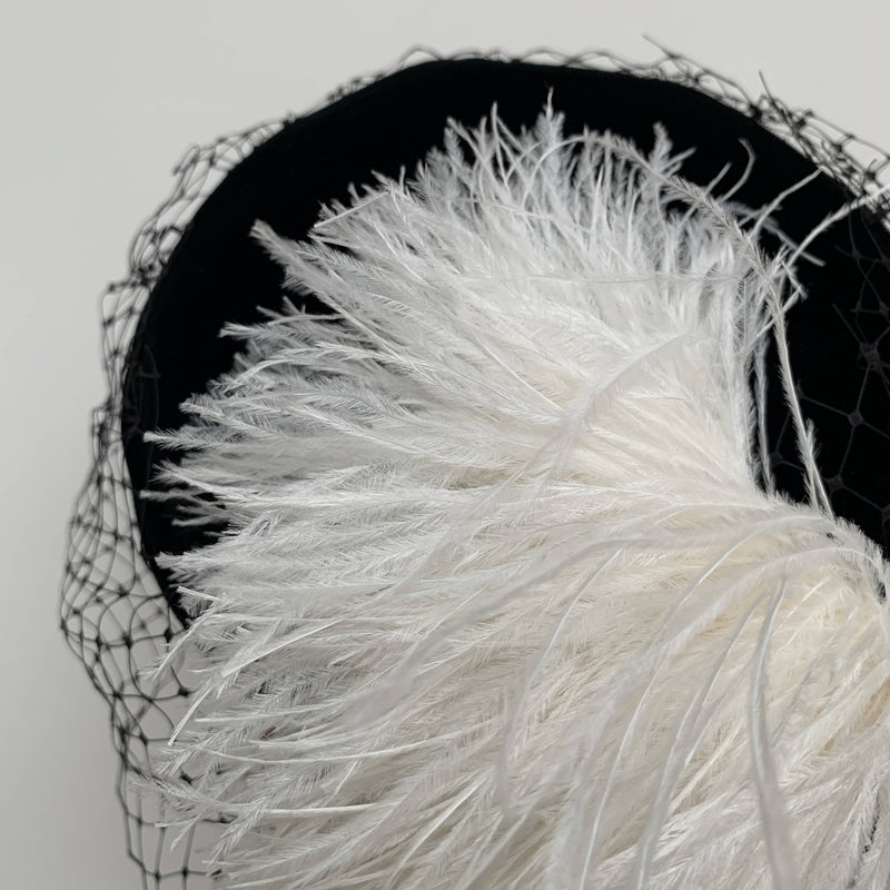 Vintage black velvet pillbox hat with net veils white feathers made in UK