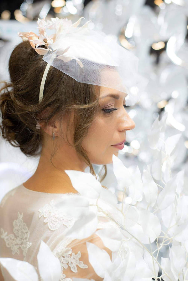 Bridal hat trimmed with silk hydrangea flowers