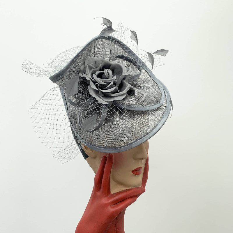 Vintage grey cocktail hat with decorative flower and net by Stephen Jones