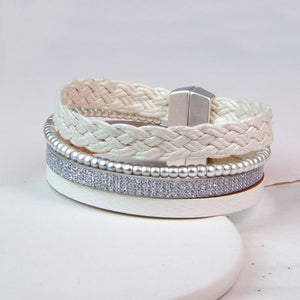 Multi strand bracelet with cream plaited leather, beads and silver