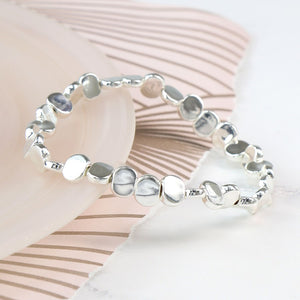 Silver plated stretch bracelet with flattened beads
