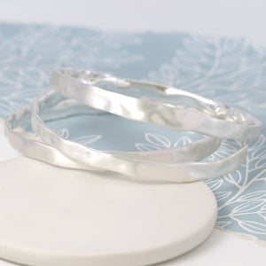 Silver plated triple hammered bangle set in a worn finish