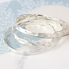 Load image into Gallery viewer, Silver plated triple hammered bangle set in a worn finish