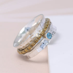 Sterling silver spinning ring with Blue Topaz gemstone