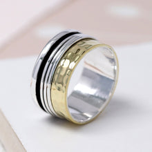Load image into Gallery viewer, Sterling silver spinning ring with brass hammered edge