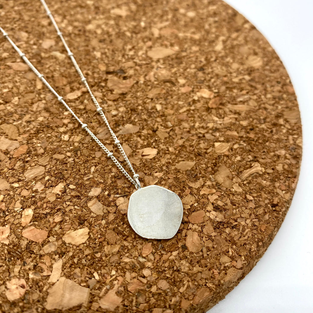 Organic shaped silver pendant on satellite chain