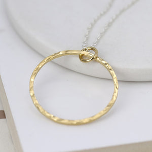 Gold hammered circle pendant on silver chain