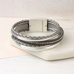 Metallic grey leather bracelet with crystals and curves