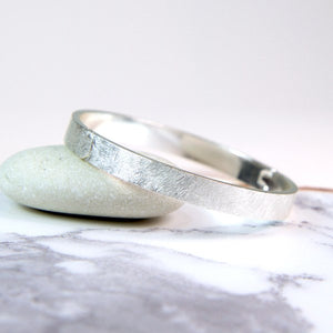Silver plated wide bangle with a scratched finish