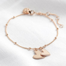Load image into Gallery viewer, Rose gold falling hearts charm bracelet