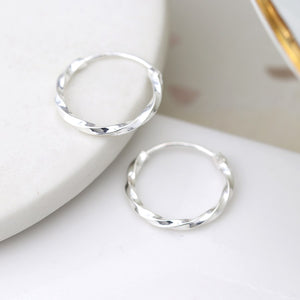 Silver smooth twisted hoop earrings