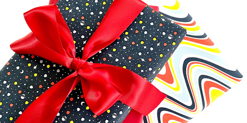 Gifts wrapped in Galaxy and Rainbow Road wrapping paper designs.