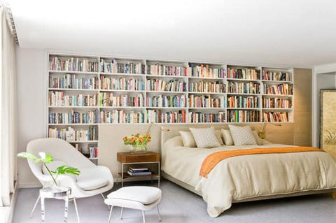 Bedroom surrounded by bookshelves