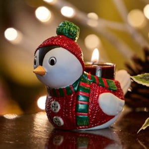 "This hand-painted porcelain bird with a red and green sweater and hat is the ideal stocking stuffer. . 3½""h, 4½""w."