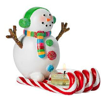Load image into Gallery viewer, Missy Mint is our fabulous new snowman tealight candle holder. Or should we say snow woman? Her candy cane sled and cute colors make her a must-have for holiday style that's all about fun. Resin.