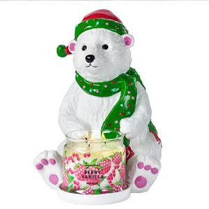 "polar bear ceramic jar holder. With hand painted green hat and scarf, he's sure to bring fun into your home. The glazed finish and glitter accents give it a Christmas glitter. Candles sold separately. 11½""h 29 cm h."