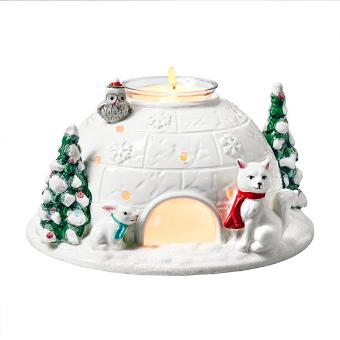 In white ceramic, cute cut outs cast a cheerful light and a festive touch is added with glitter details of Christmas trees and woodland animals. Includes a clear glass cup suspended in center of igloo roof. Illuminate with a votive or a tealight in the cup. Candles sold separately. 3½