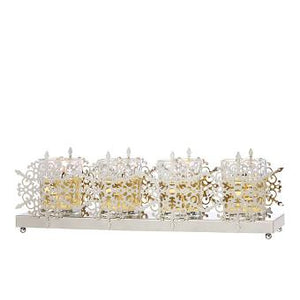 our Silvery Snowflake Candle Holder is ideal for your winter home. The double row of metal silvery snowflakes holds 4 tall glass cups. Illuminate yours with votives or tealights.