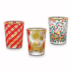 "glass votive trio with decals is the perfect Holiday choice. Display the contrasting designs of red stripes; gold starbursts; multi-color polka dots. One of each pattern included. Illuminate with votives and tealights. Candles sold separately. 3¼""h 8 cm h."