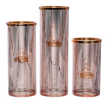 Load image into Gallery viewer, Pinstripe Glam Tealight Holder Trio, a set of 3 glass holders with metallic rose gold pinstripe detail. They include matching metal tealight hangers. Each /set includes one each of 3 heights: 28 cm h; 23 cm h; 18 cm h.