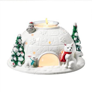 "In white ceramic, cute cut outs cast a cheerful light and a festive touch is added with glitter details of Christmas trees and woodland animals. Includes a clear glass cup suspended in center of igloo roof. Illuminate with a votive or a tealight in the cup. Candles sold separately. 3½""h 9 cm h."