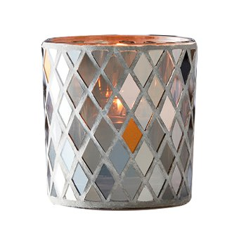 This votive candle holder features white and gold tiles mingled with reflective glass in a mosaic diamond pattern. Enjoy unique reflections with your choice of votive or tealight burning inside. Mosaic glass. Includes glass cup (In cup: votive, tealight). 9 cm h
