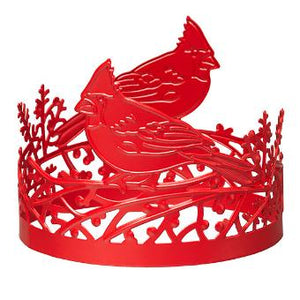 "Cut-out cardinal birds sit atop sprigs in a design that perfectly wraps your favorite fragranced 3-Wick Jar Candle. Use alone or pair it with a jar stand or pedestal. Metal. Measures 9 cm h., 11 cm w. 3 ½"" h."