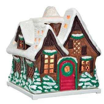 charming, hand painted, ceramic gingerbread cottage jar holder. A charming design in brown, green, red and white, it has a glazed finish and cut outs to cast a glow. Illuminate with jars, sold separately. 10