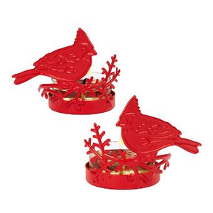 "A matching pair of red cardinals sit atop seasonal sprigs, in metal cut-out that wraps your choice of tealights. Metal. Set of 2. Measures 6 cm h, 7 cm w. 2¼""h, 2¾""w."