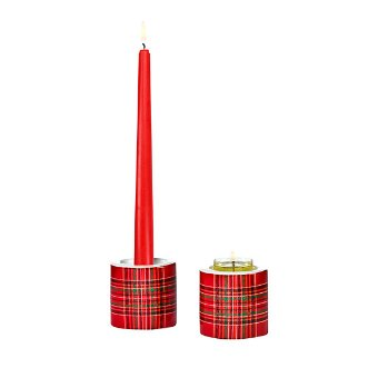 This tealight candle holder set of two is simple yet stylish in ceramic. Also holds taper candles. (Tealight, taper). 6 cm h, 7 cm w. 2½