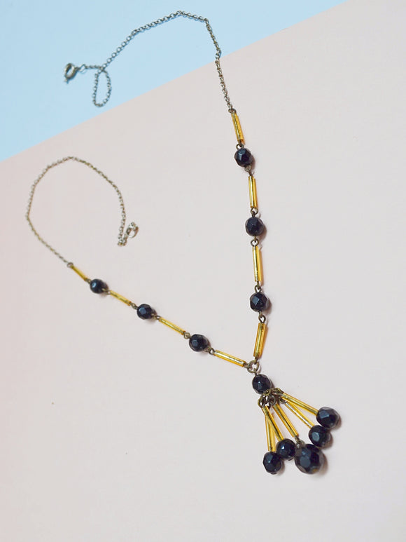 1930s Black & gold yellow glass bead tassel necklace