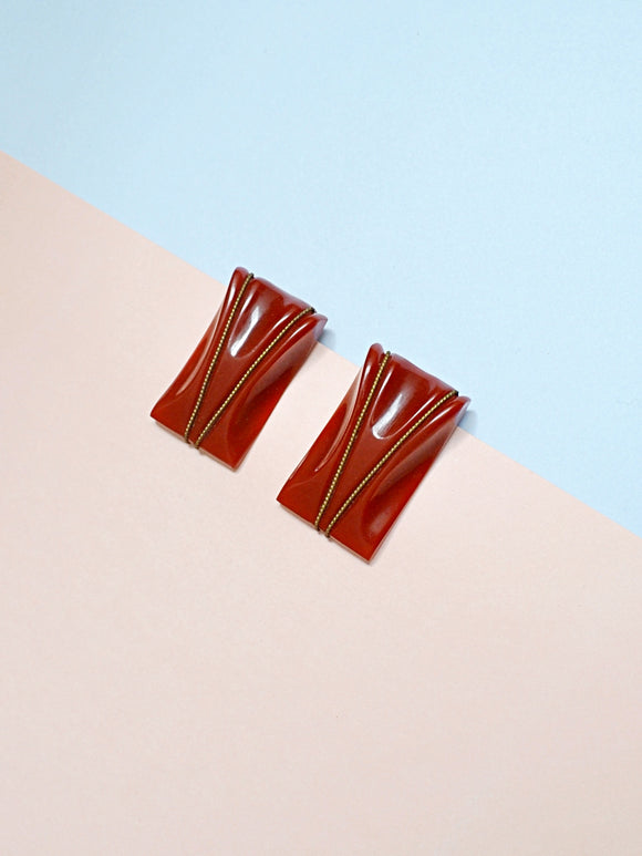 1930s Dark red carved Bakelite & brass dress clips