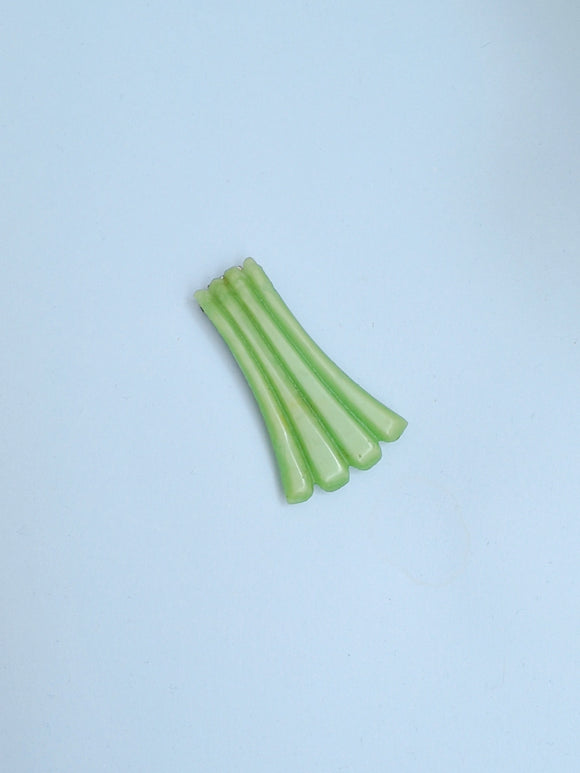 1930s Pastel green carved Galalith dress clip