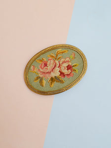 The Guinevere buckle in needlework and brass
