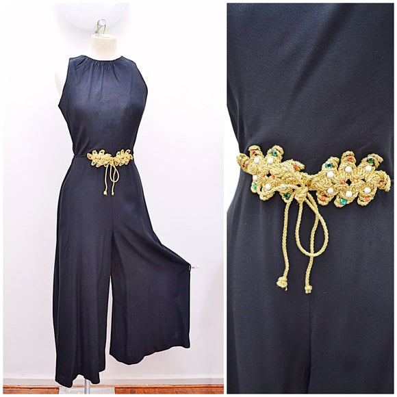 1960s Black rayon crepe palazzo leg jumpsuit with rhinestone gold braid