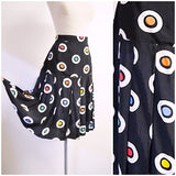 1980s Black & white rayon pleated skirt with orange/blue/red polka dot