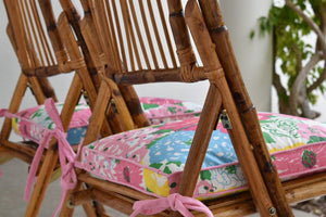Lilly cushions on bamboo chairs on garden patio