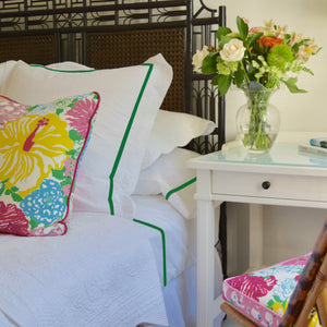 throw pillow on bed with luxury bed linen set and headboard