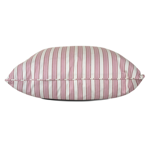 throw pillow in pink and white striped fabric